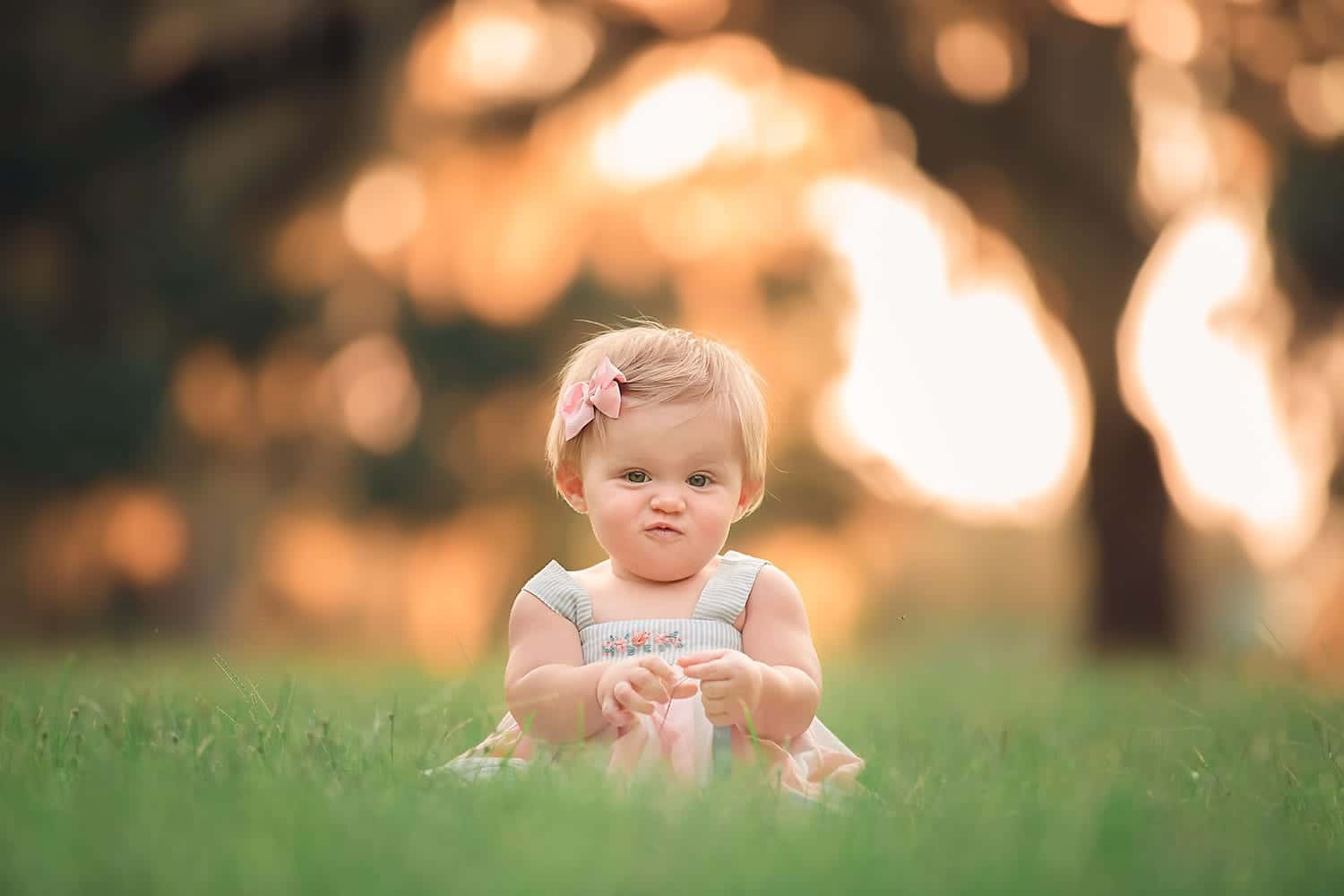 cute baby with scrunchy nose by Annie Whitaker Photography