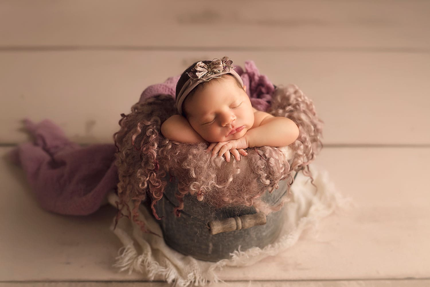 Precious newborn girl in bucket by Annie Whitaker Photography
