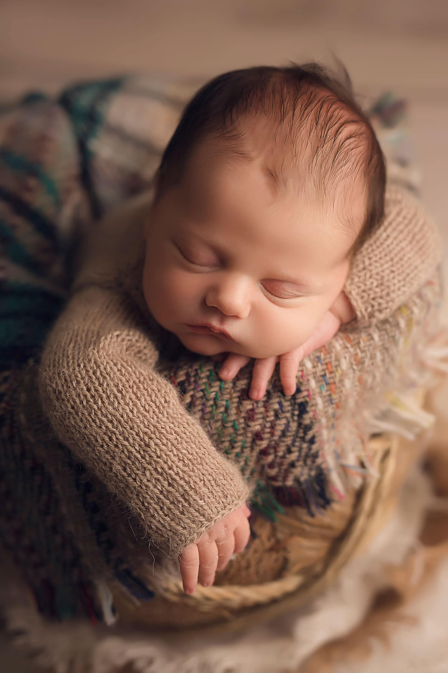 Baby boy hanging arm over basket by Annie Whitaker Photography