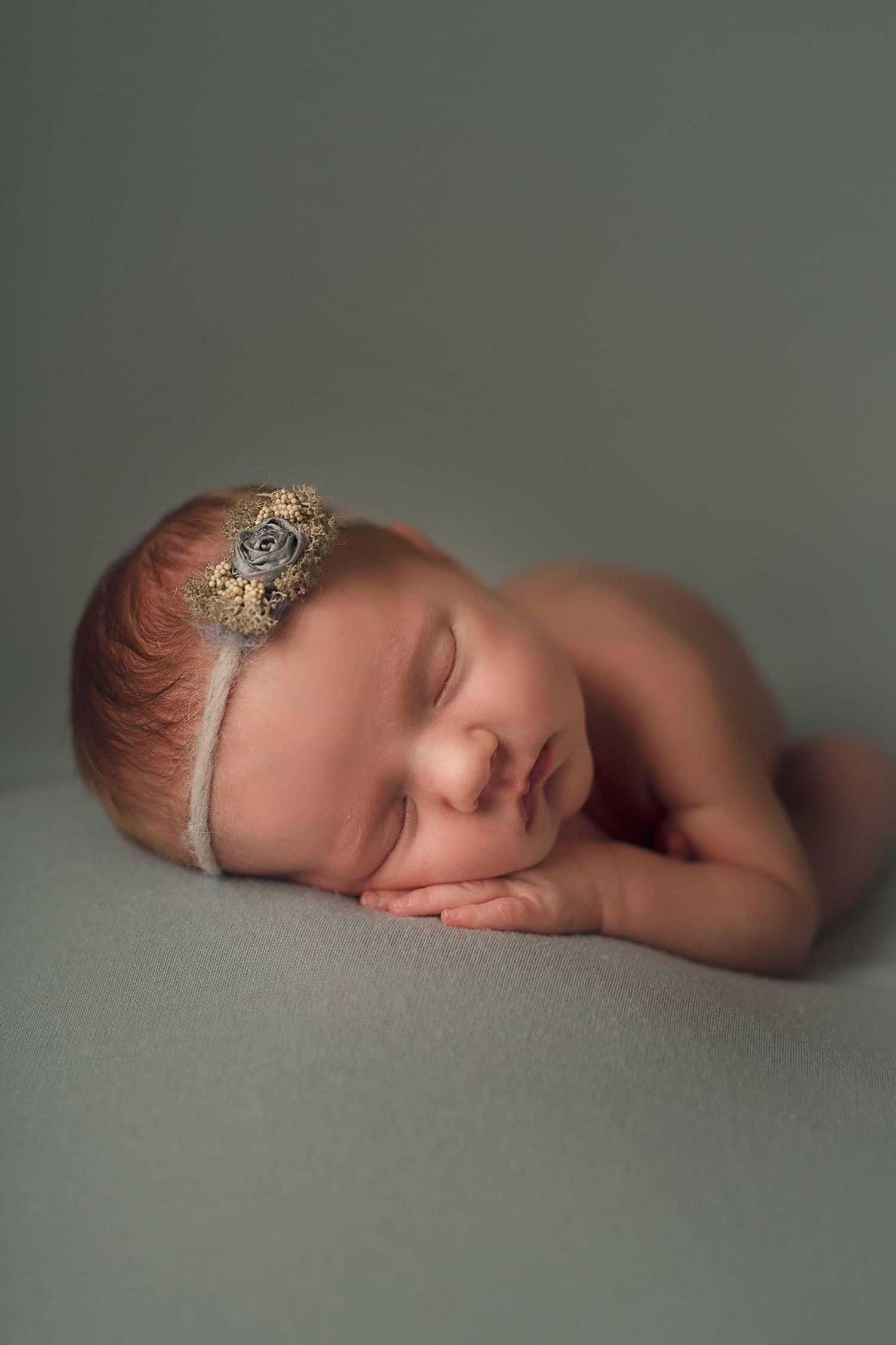 newborn girl in blue by Annie Whitaker Photography