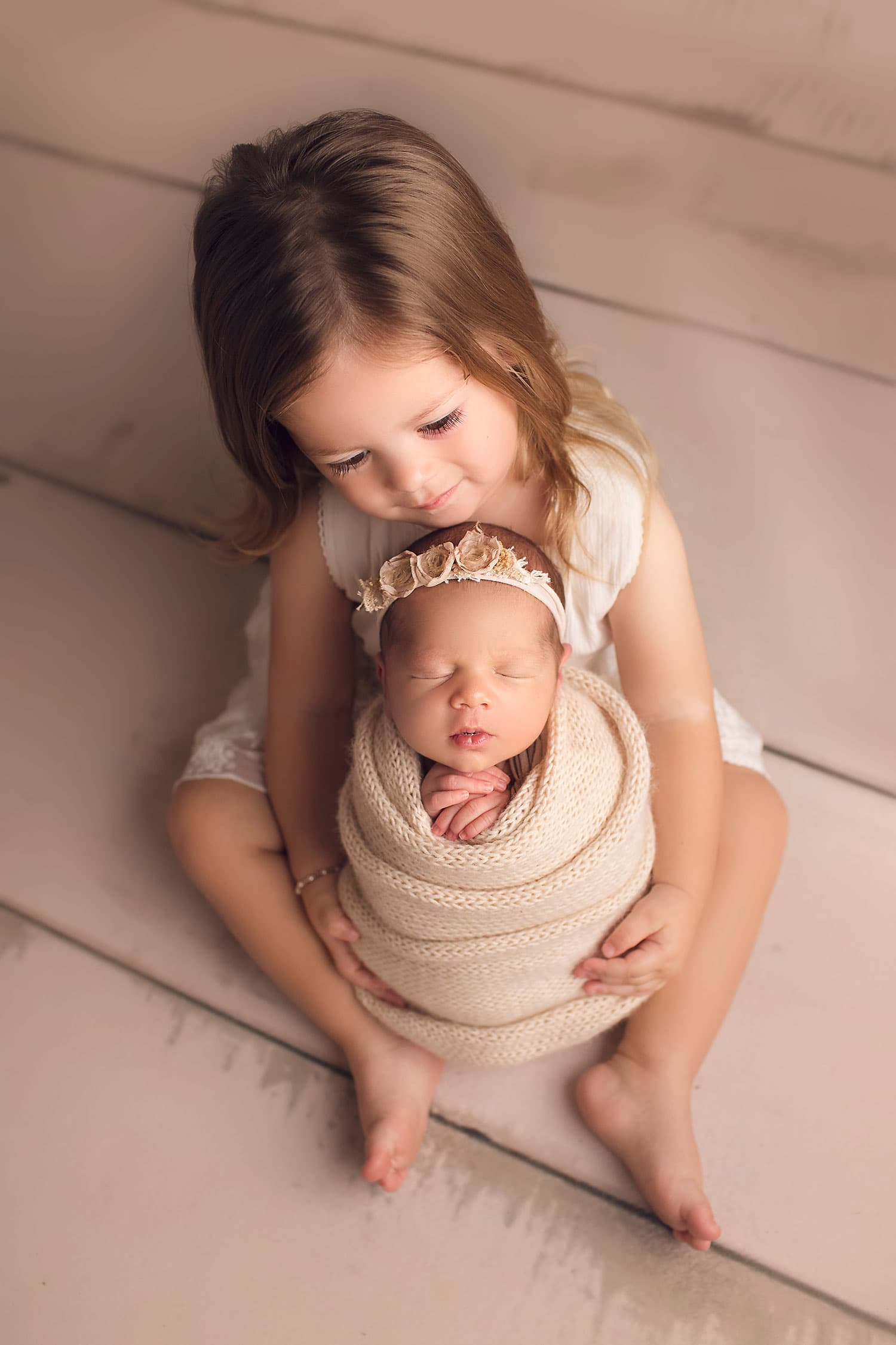 Sweet sister with newborn by Annie Whitaker Photography