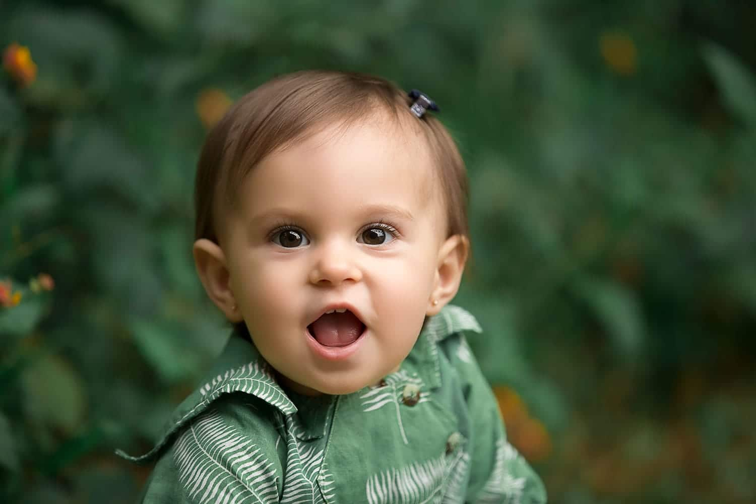 beautiful baby girl wearing green dress by Annie Whitaker Photography