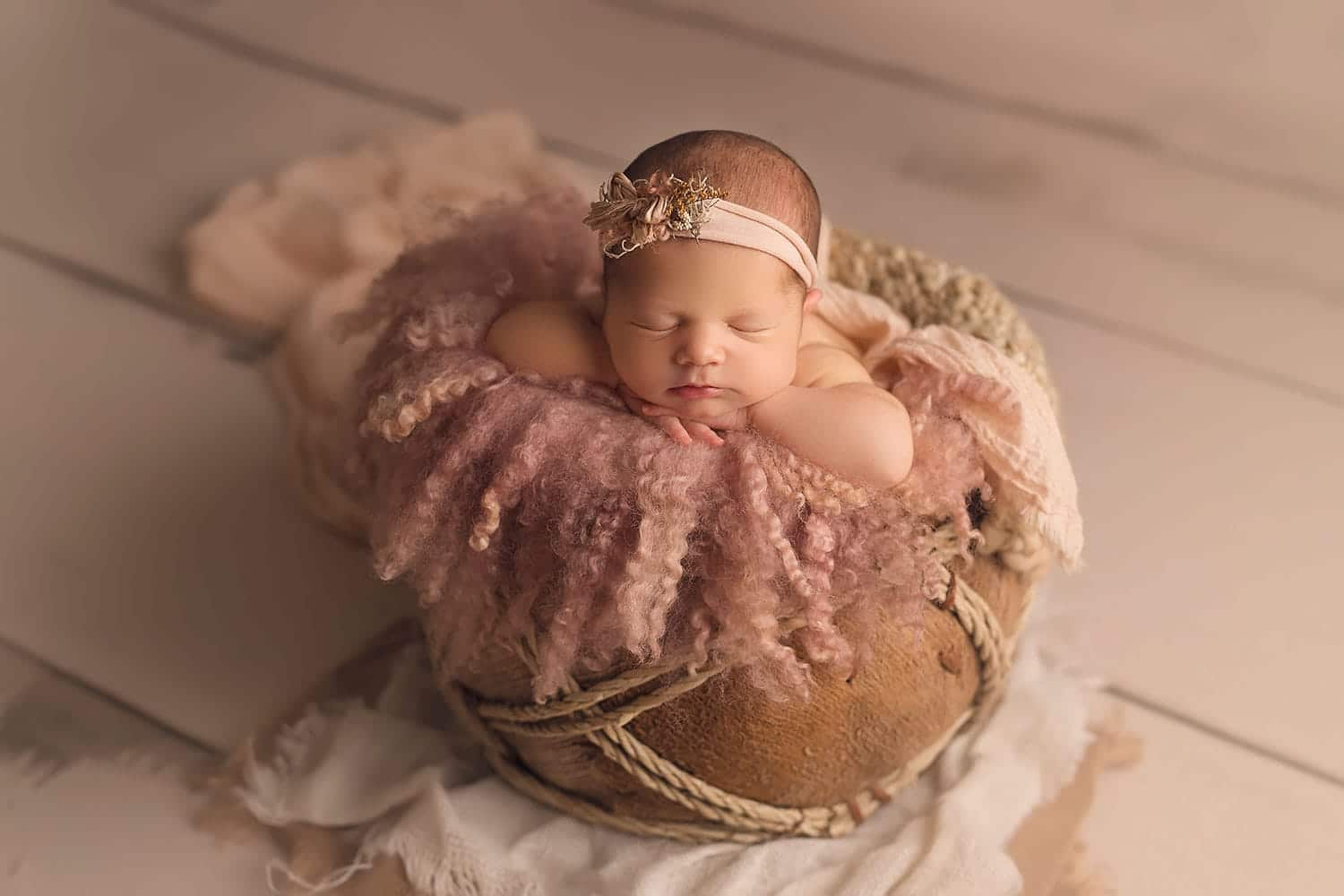 Baby in tan basket by Annie Whitaker Photography