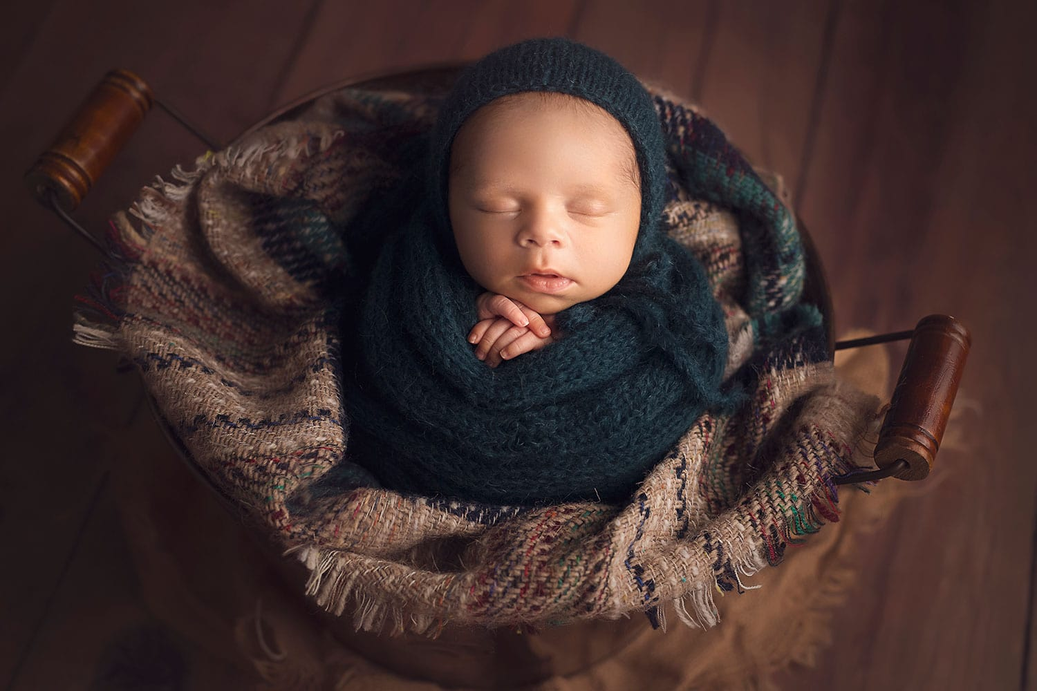 Baby in a bucket by Annie Whitaker PHotography