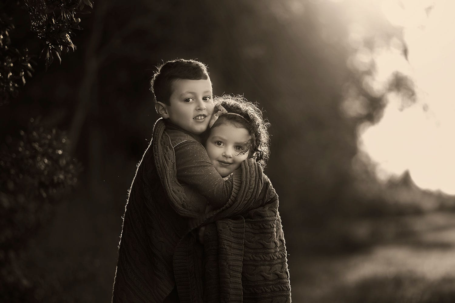 brother hugging sister by Annie Whitaker Photography