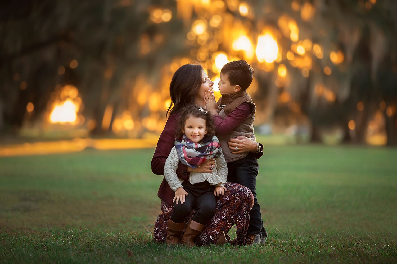 mother with daughter and son at sunset by Annie Whitaker Photography