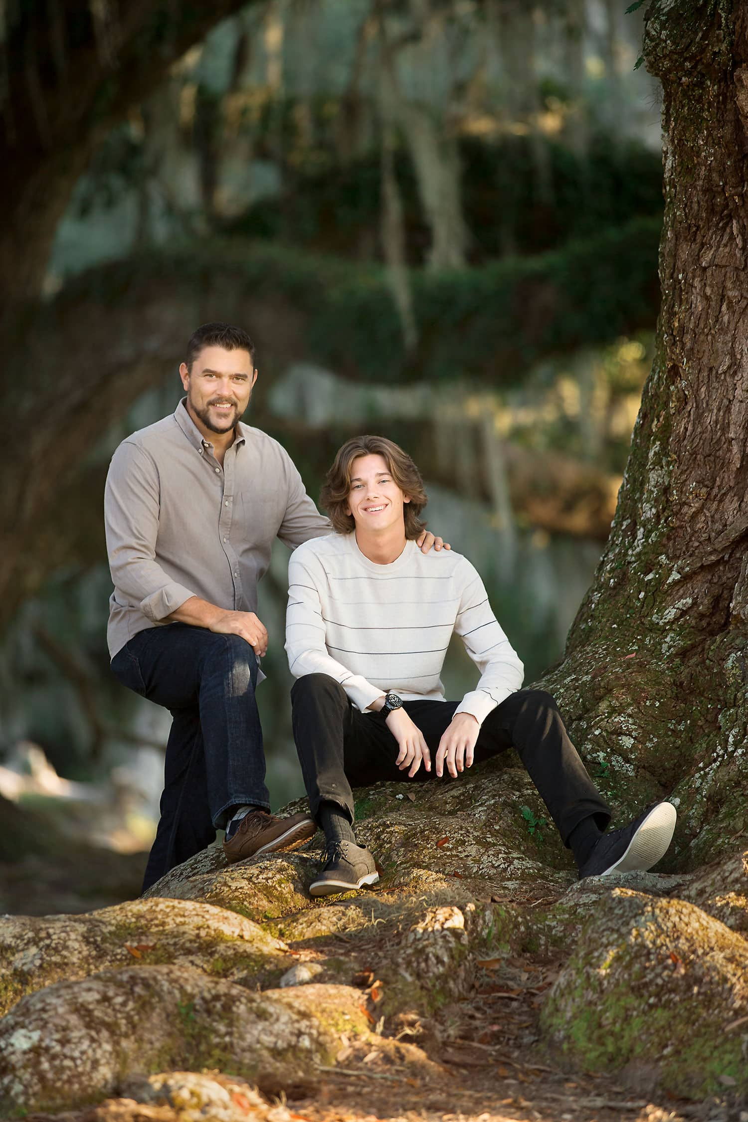 Dad and son in oak tree by Annie Whitaker Photography