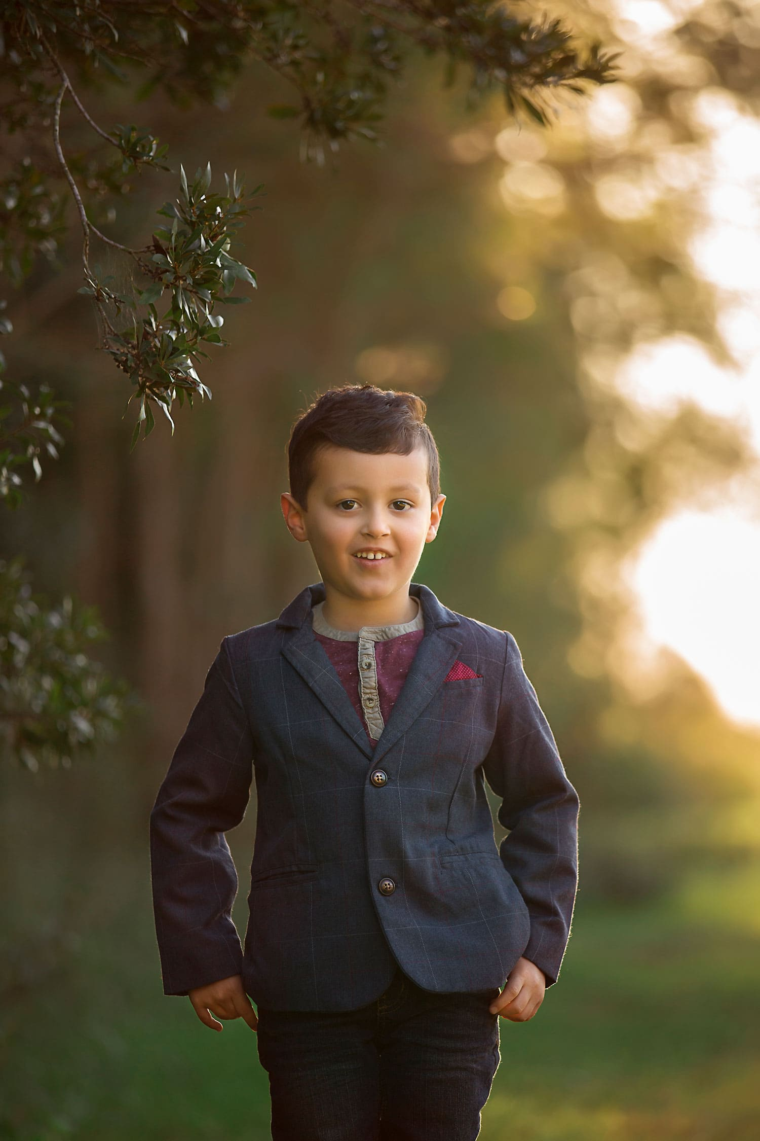 5 year old boy posing by tree by Annie Whitaker Photography