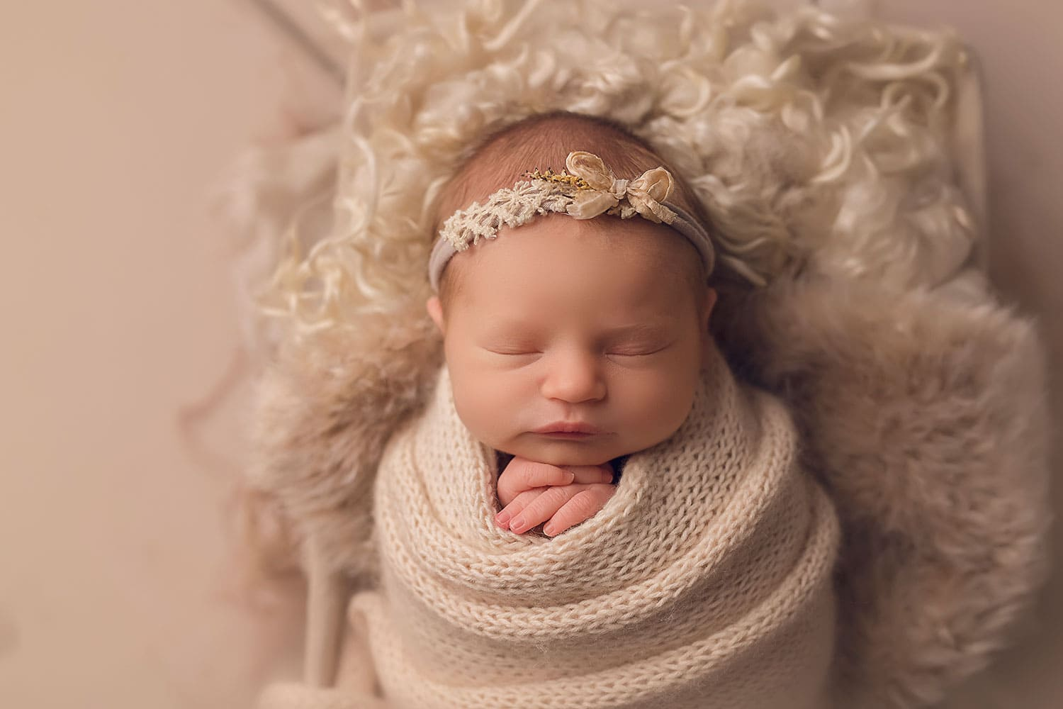 Sweet baby girl on cream fluff by Annie Whitaker Photography