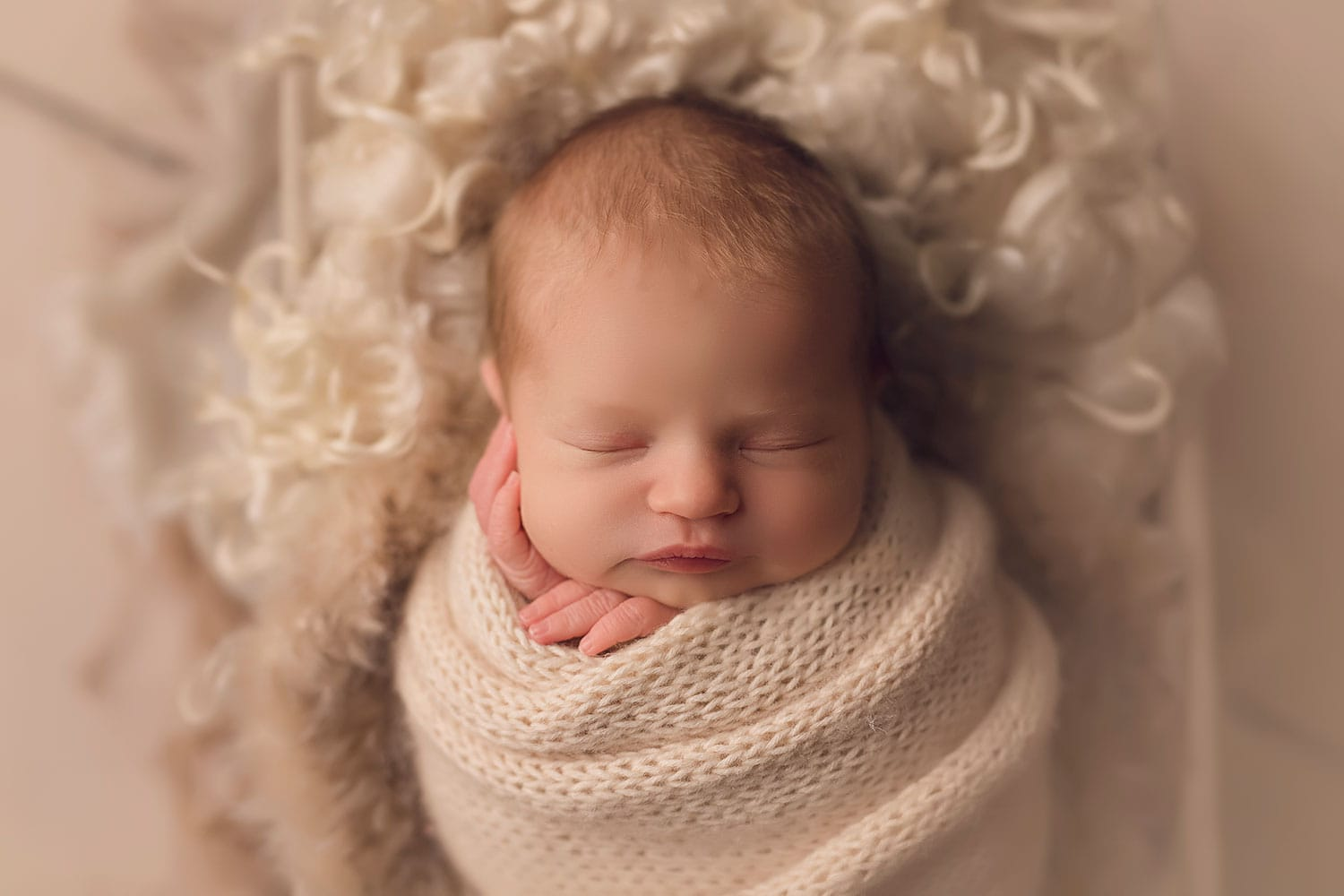 Newborn girl with blond hair by Annie Whitaker Photography