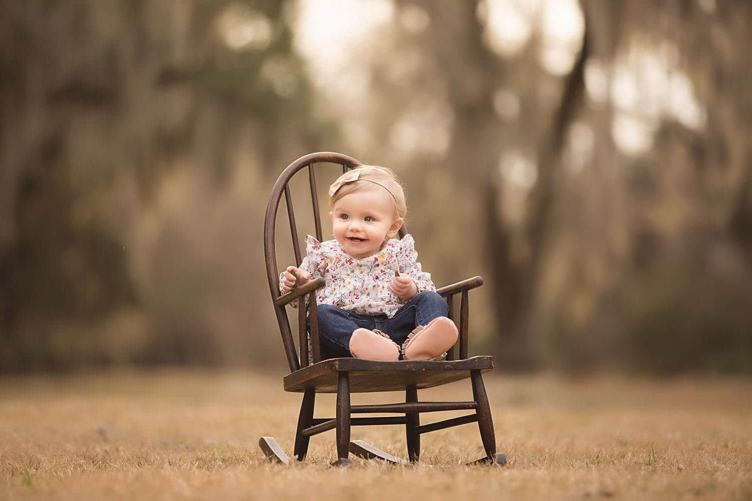 baby girl in rocking chair at park by Annie Whitaker PHotgrpahy