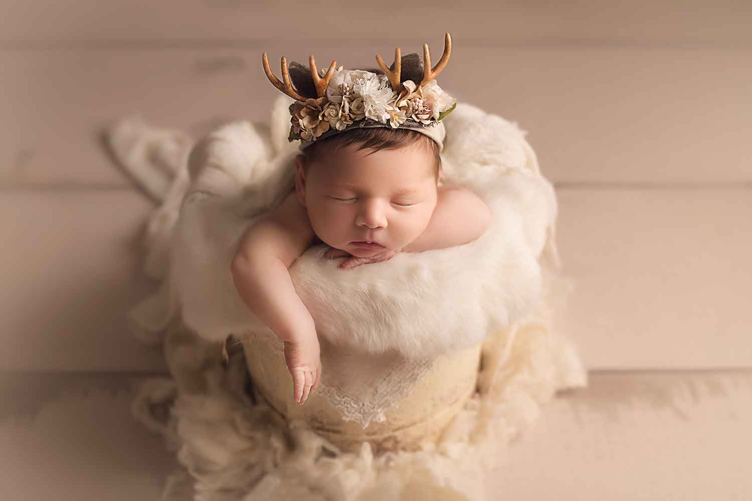 newborn baby with deer antlers