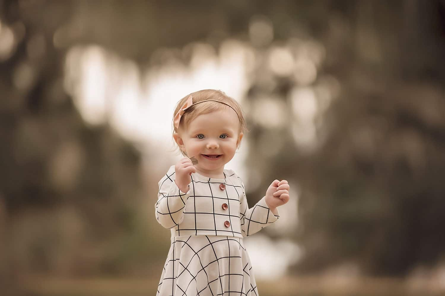 Baby girl smiling at sunset by Annie Whitaker Photography