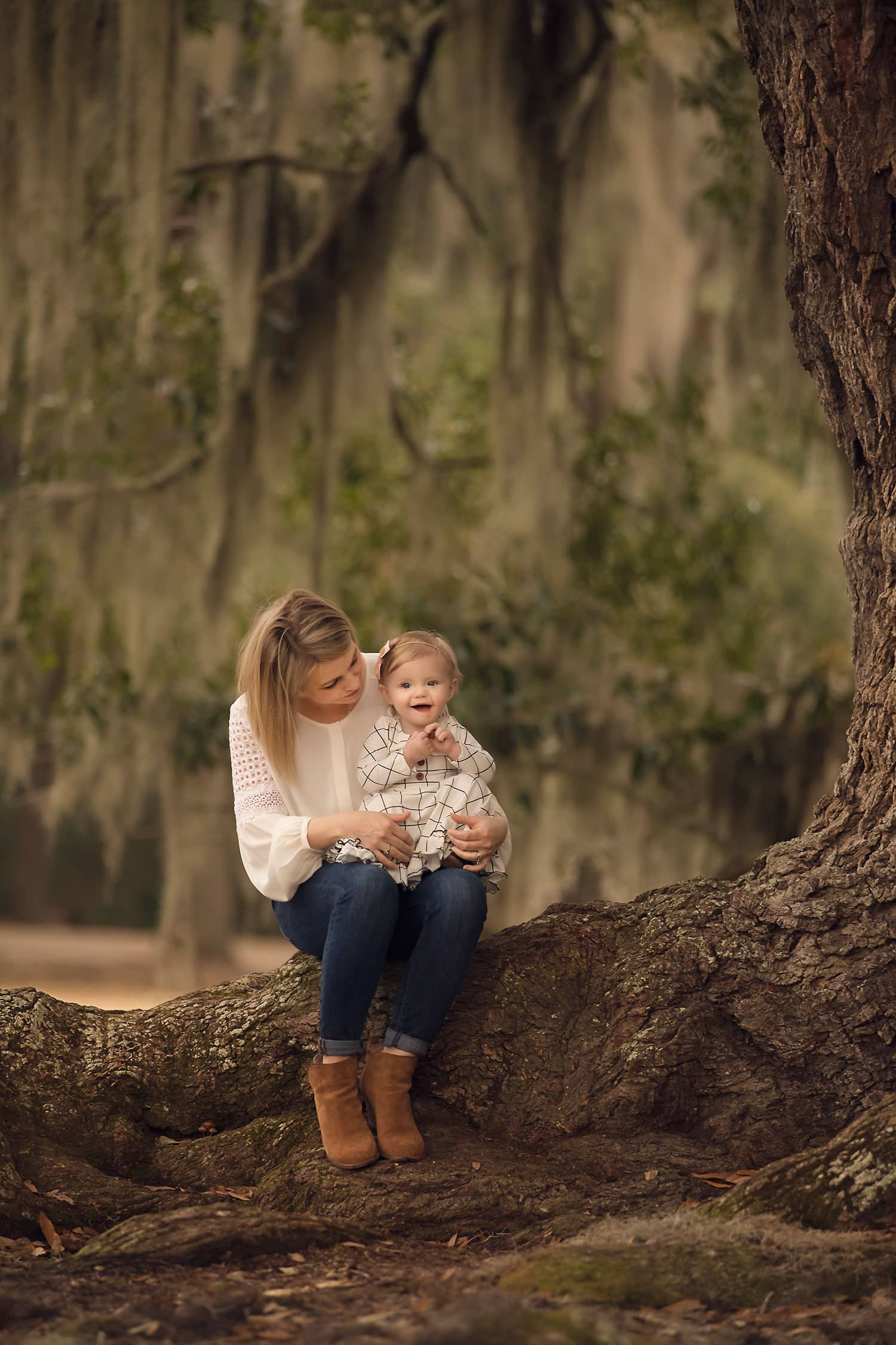 baby girl sitting on mothers lap by Annie Whitaker Photography