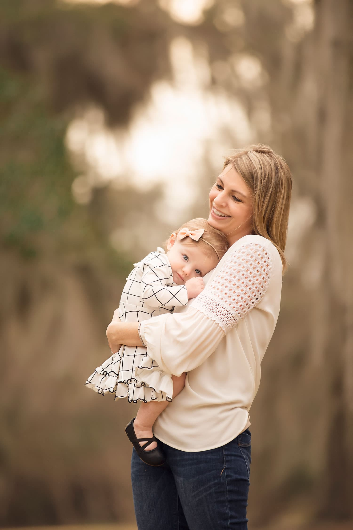 baby girl snuggling mom at sunset by Annie Whitaker Photography