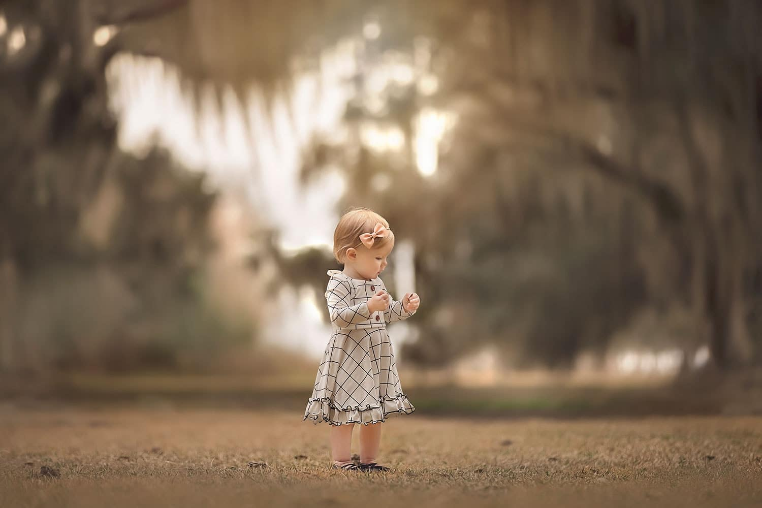 one year old girl holding leaf by Annie Whitaker Photography