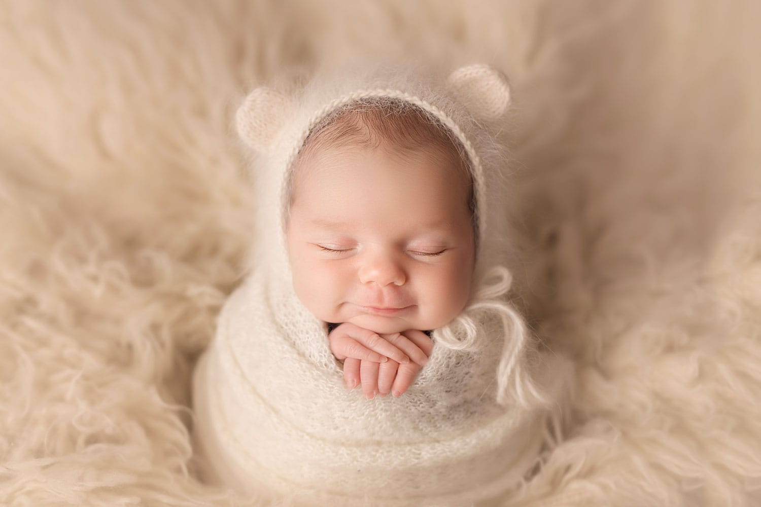 Newborn in potato sac pose by Annie Whitaker Photography