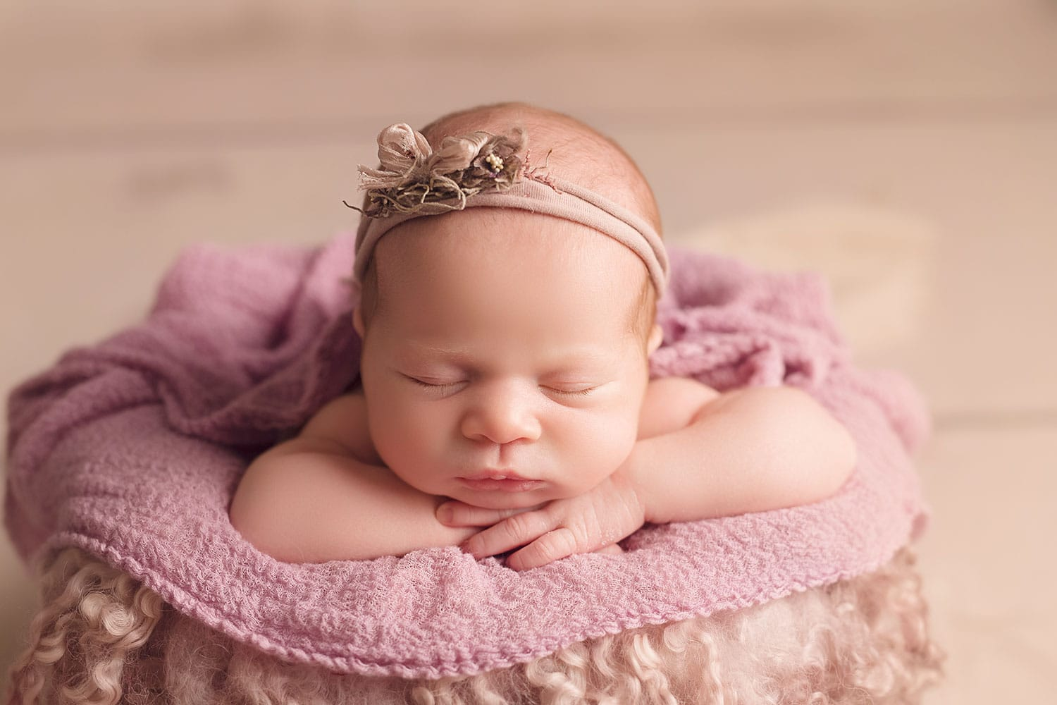 Newborn girl in lavender set up