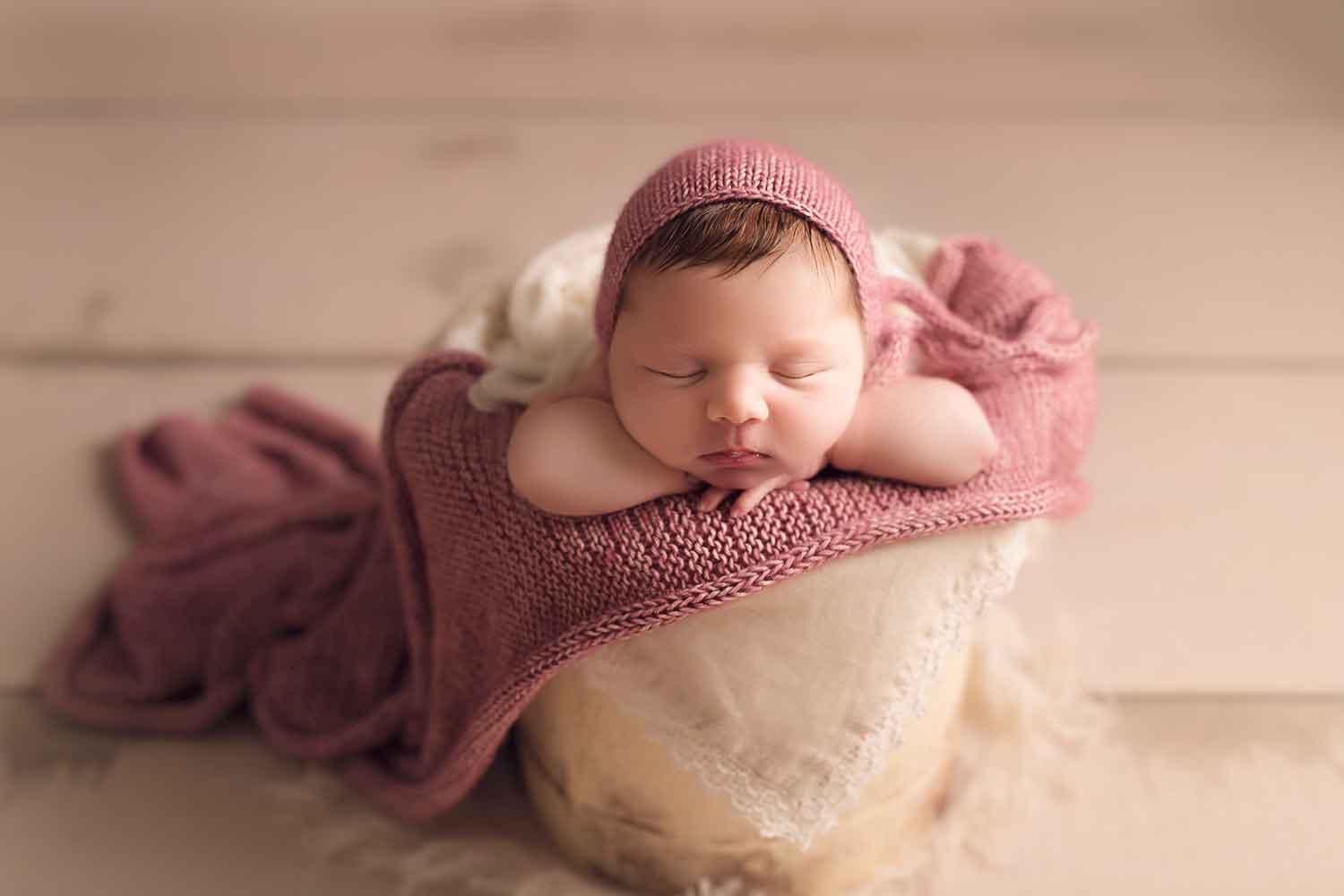newborn baby girl in purple knit wrap
