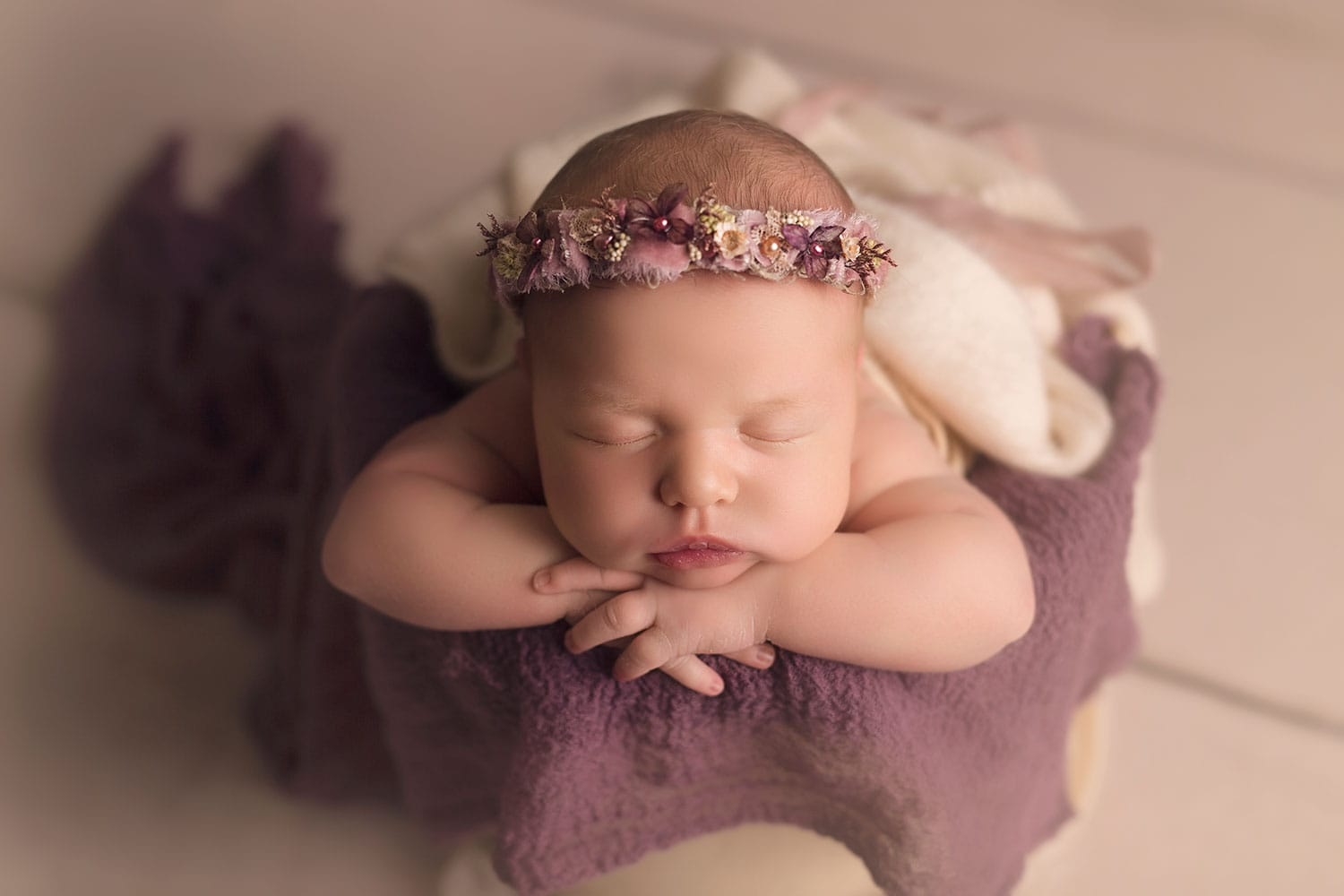 baby girl in bucket at New Orleans newborn session