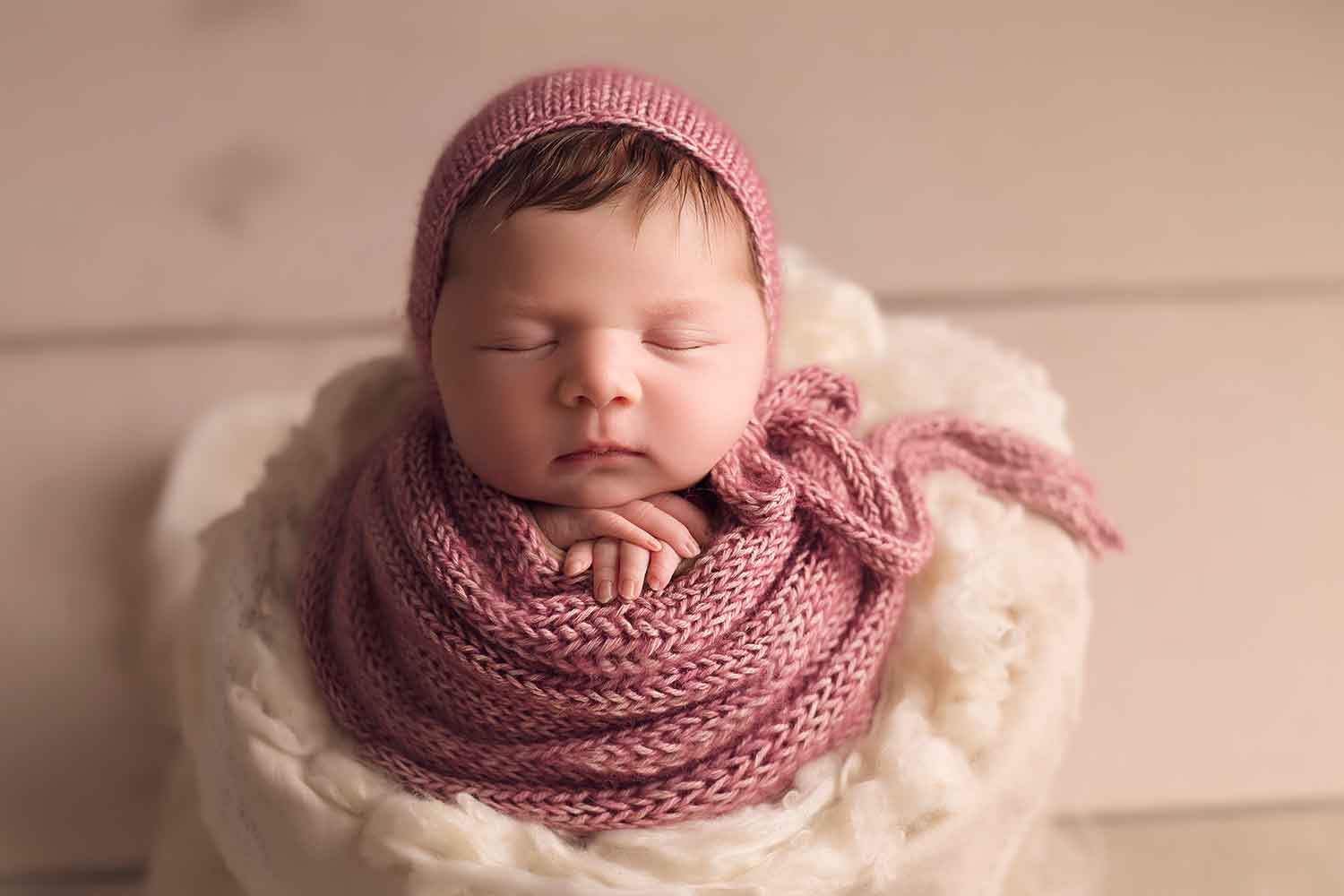newborn girl in potato sac pose