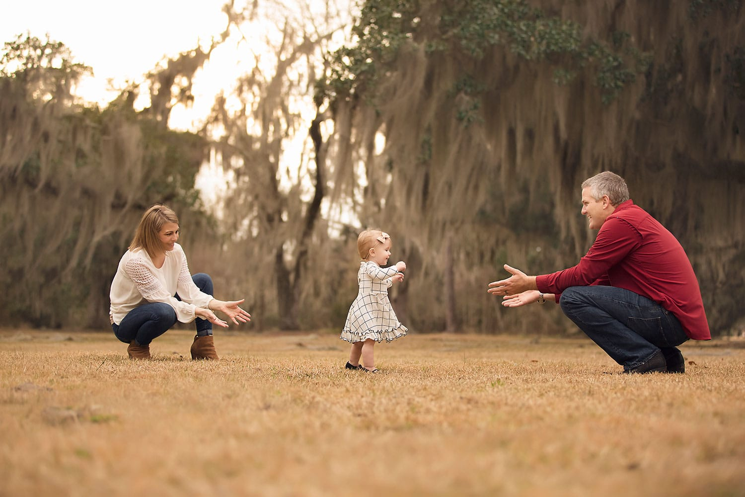 one year old taking steps to dad at park by Annie Whitaker PHotography
