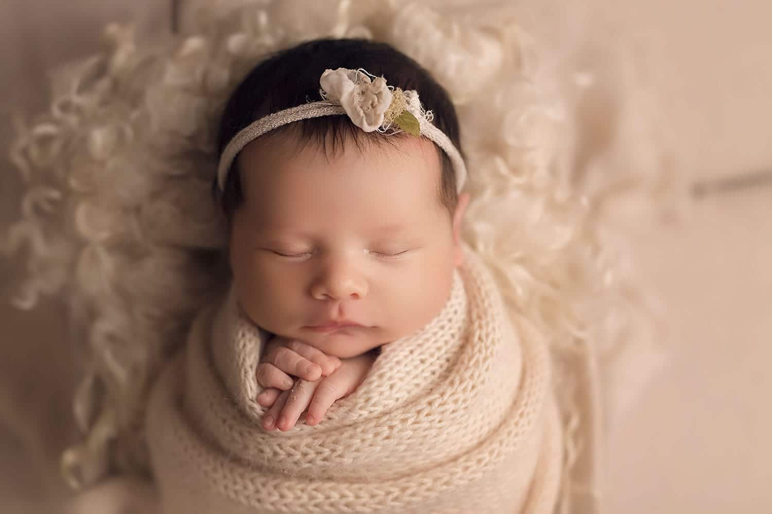 Newborn girl in all cream set up by Annie Whitaker Photography