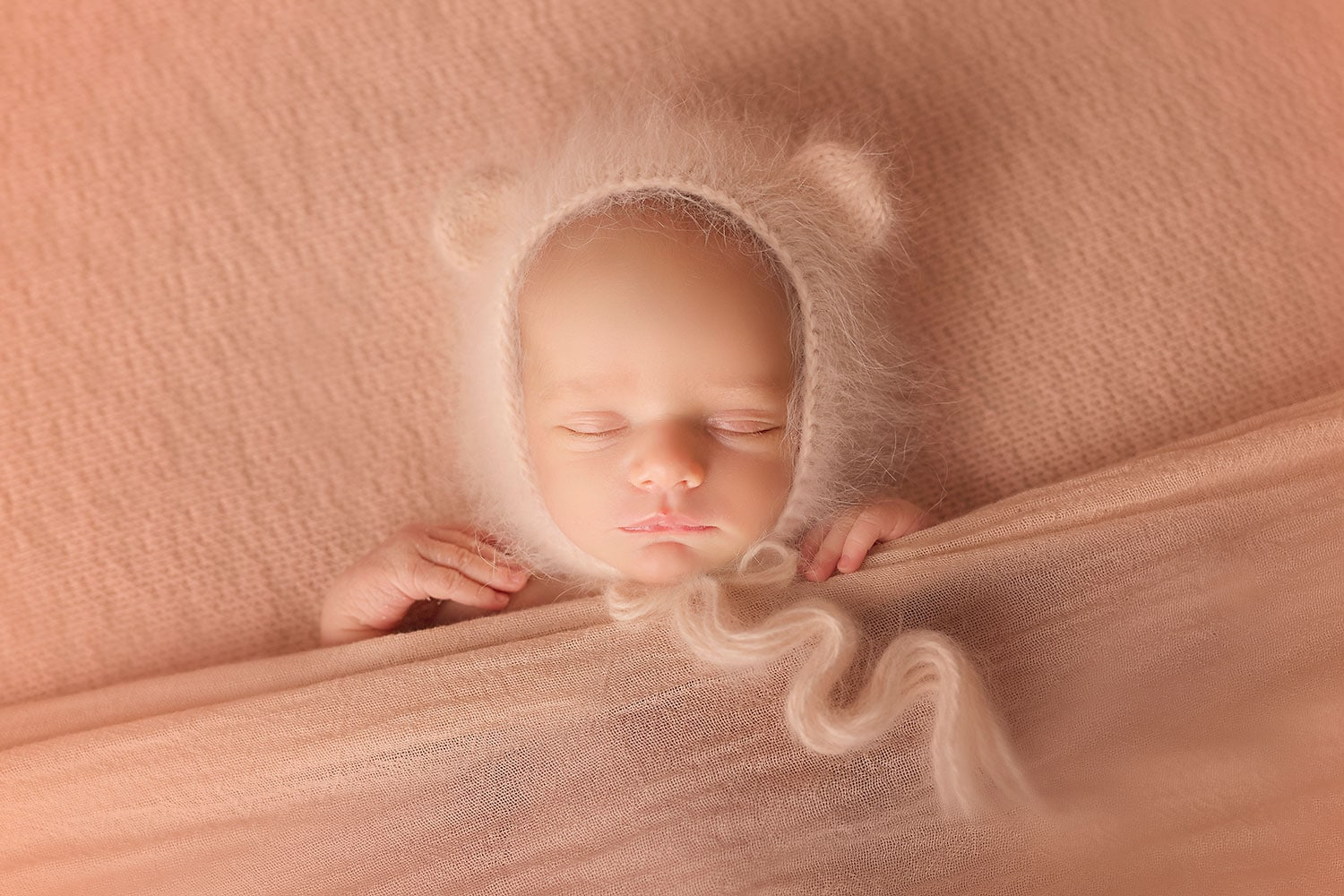 baby girl sleeping in bear bonnet by Annie Whitaker Photography