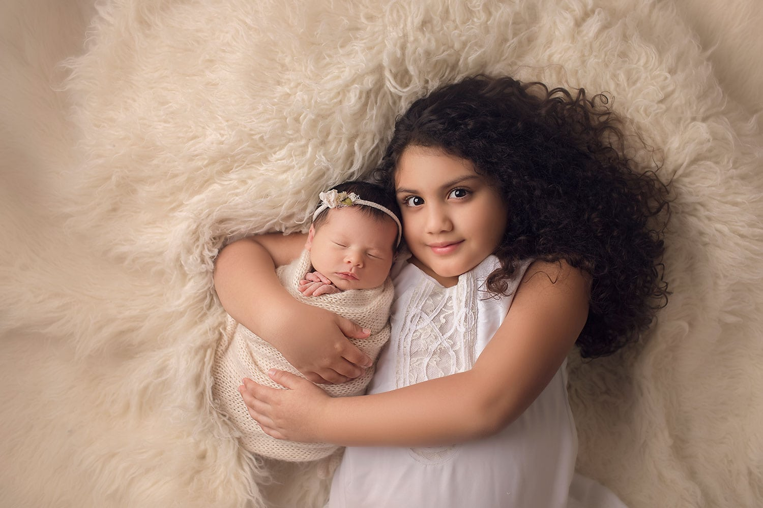 Big sister holding newborn by Annie Whitaker Photography
