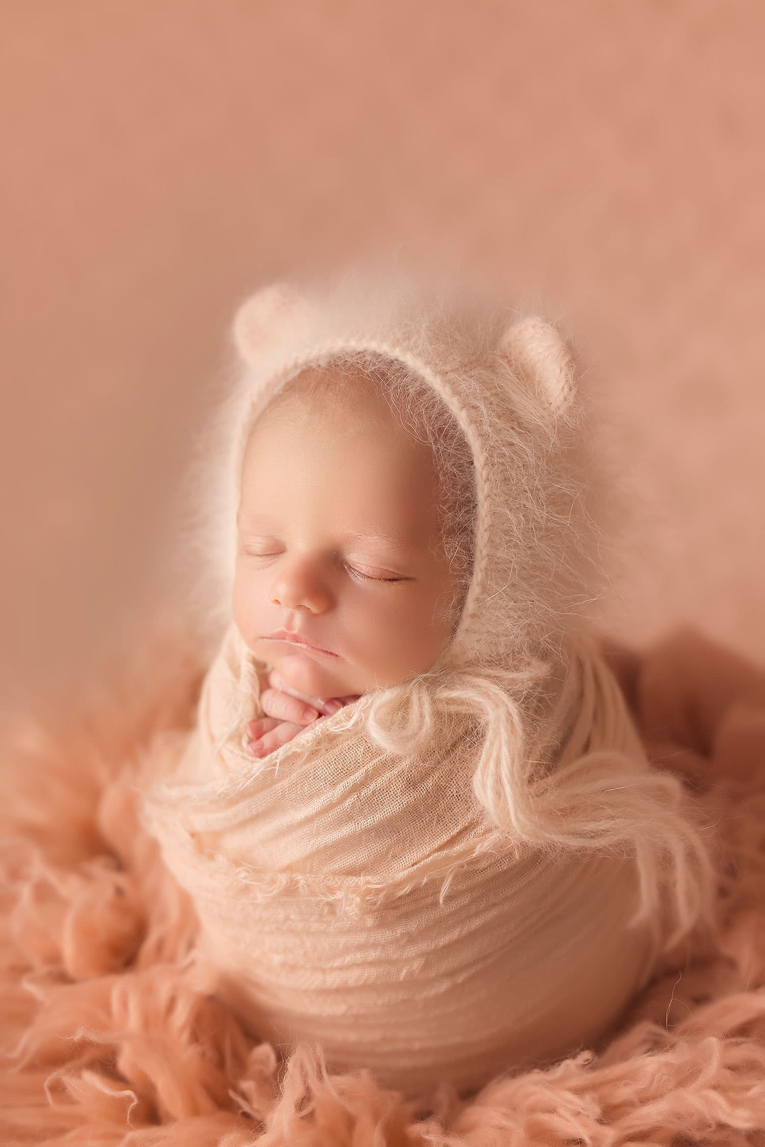 newborn baby in potato sac pose with bear bonnet by Annie Whitaker Photography