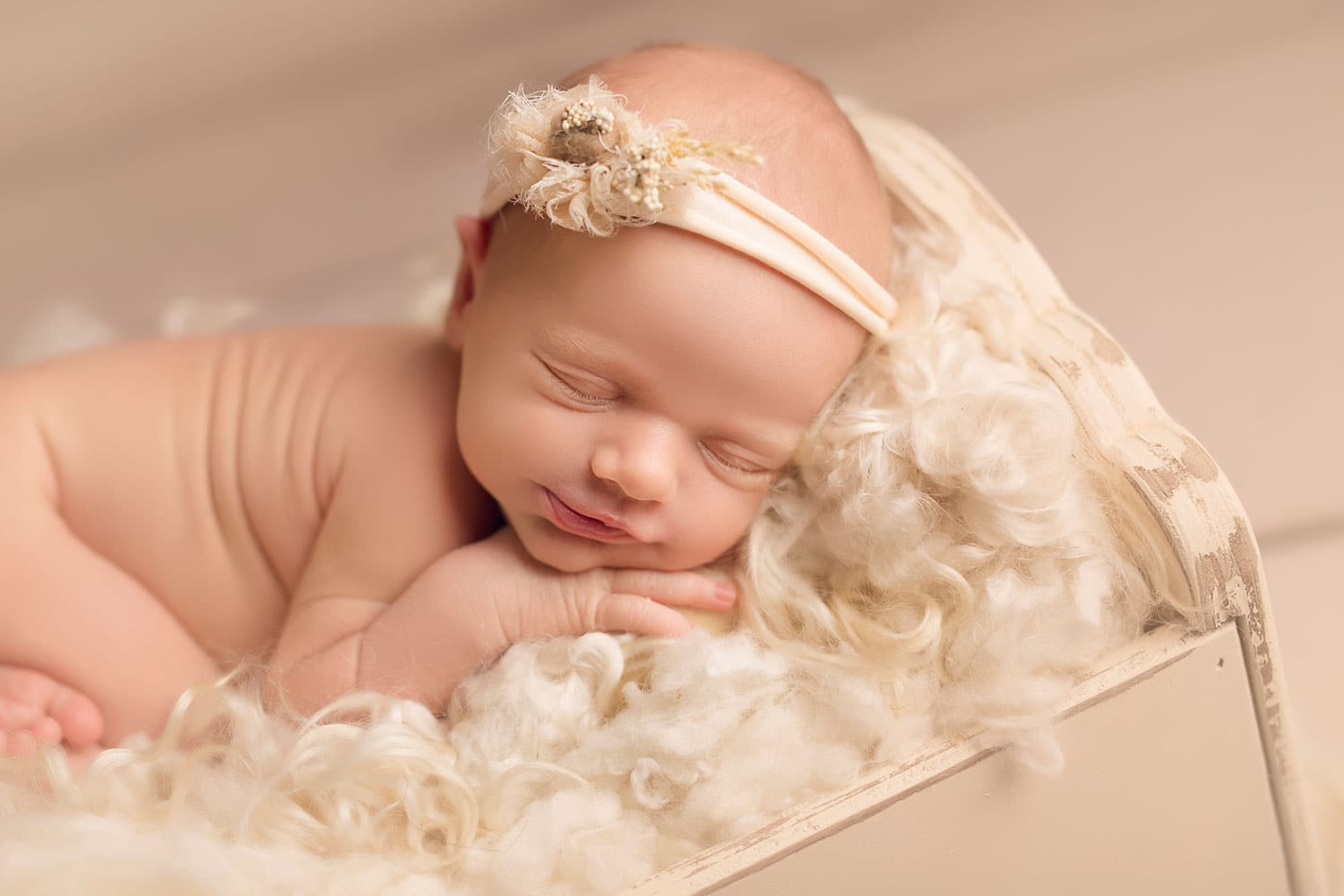 Baby sleeping on Cwtchicoo fluff by Annie Whitaker Photography