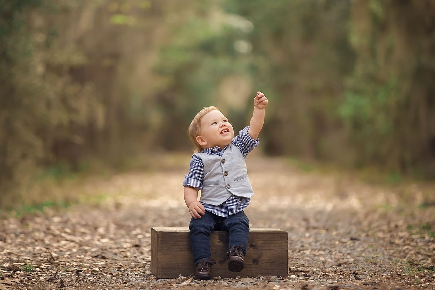 Baby boy pointing at sky by Annie Whitaker Photography