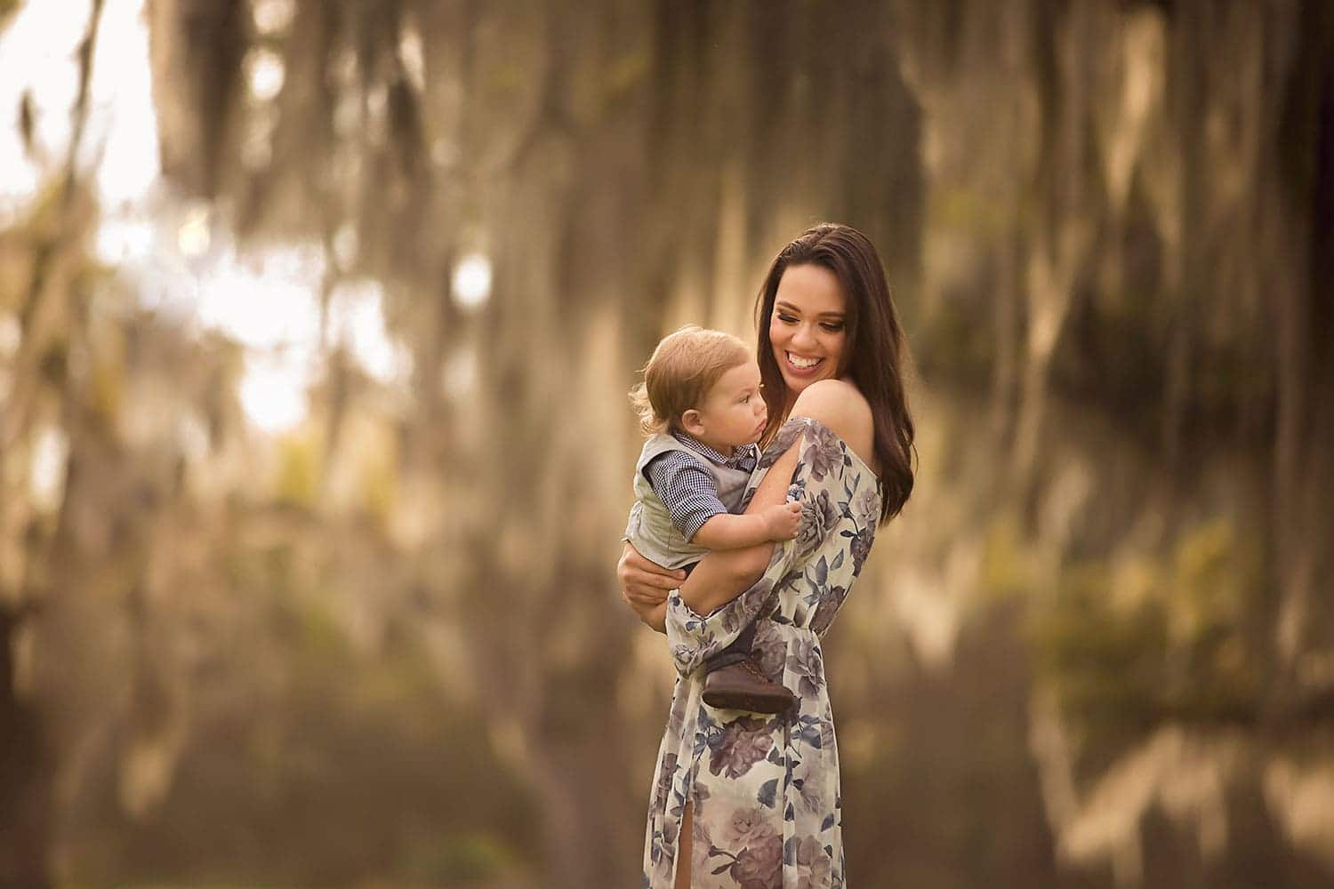 Mother holding baby boy by Annie Whitaker Photography