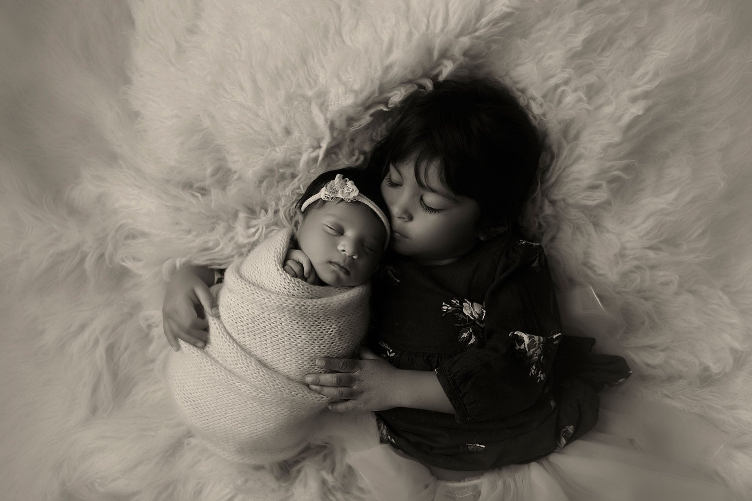 newborn baby girl with sister by Annie Whitaker Photography