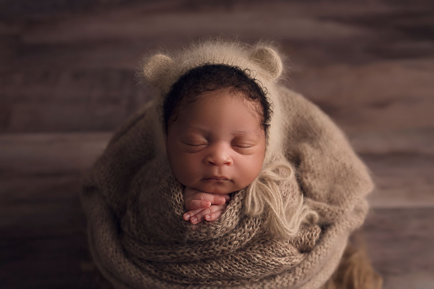 Newborn boy in bear bonnet by Annie Whitaker Photography