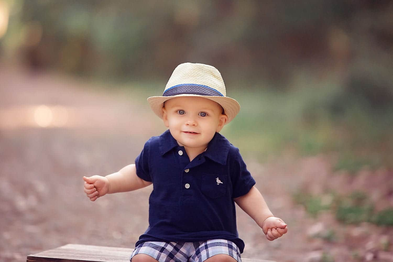 One year old boy in little hat by Annie Whitaker Photography