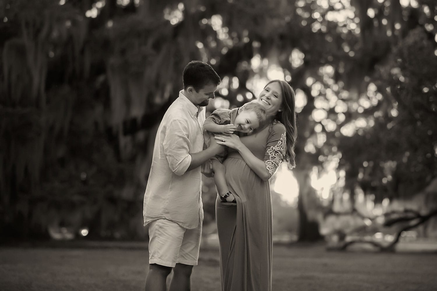 beautiful black and white photo of mother and father with baby boy by Annie Whitaker Photography