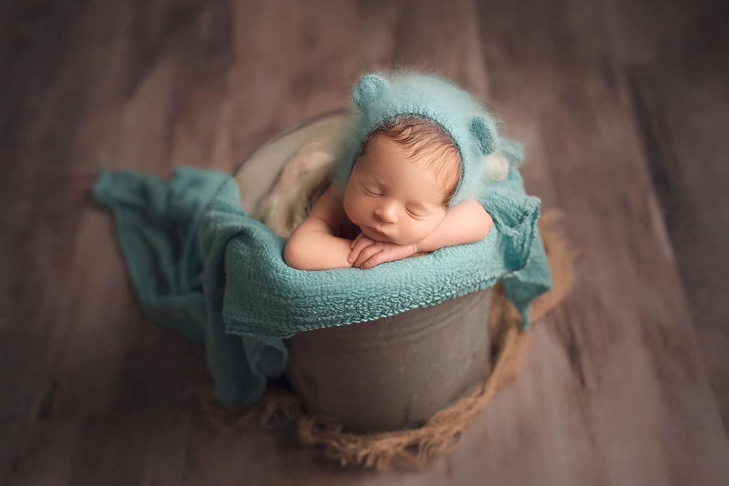 Precious newborn boy in bear bonnet by Annie WHitaker PHotography