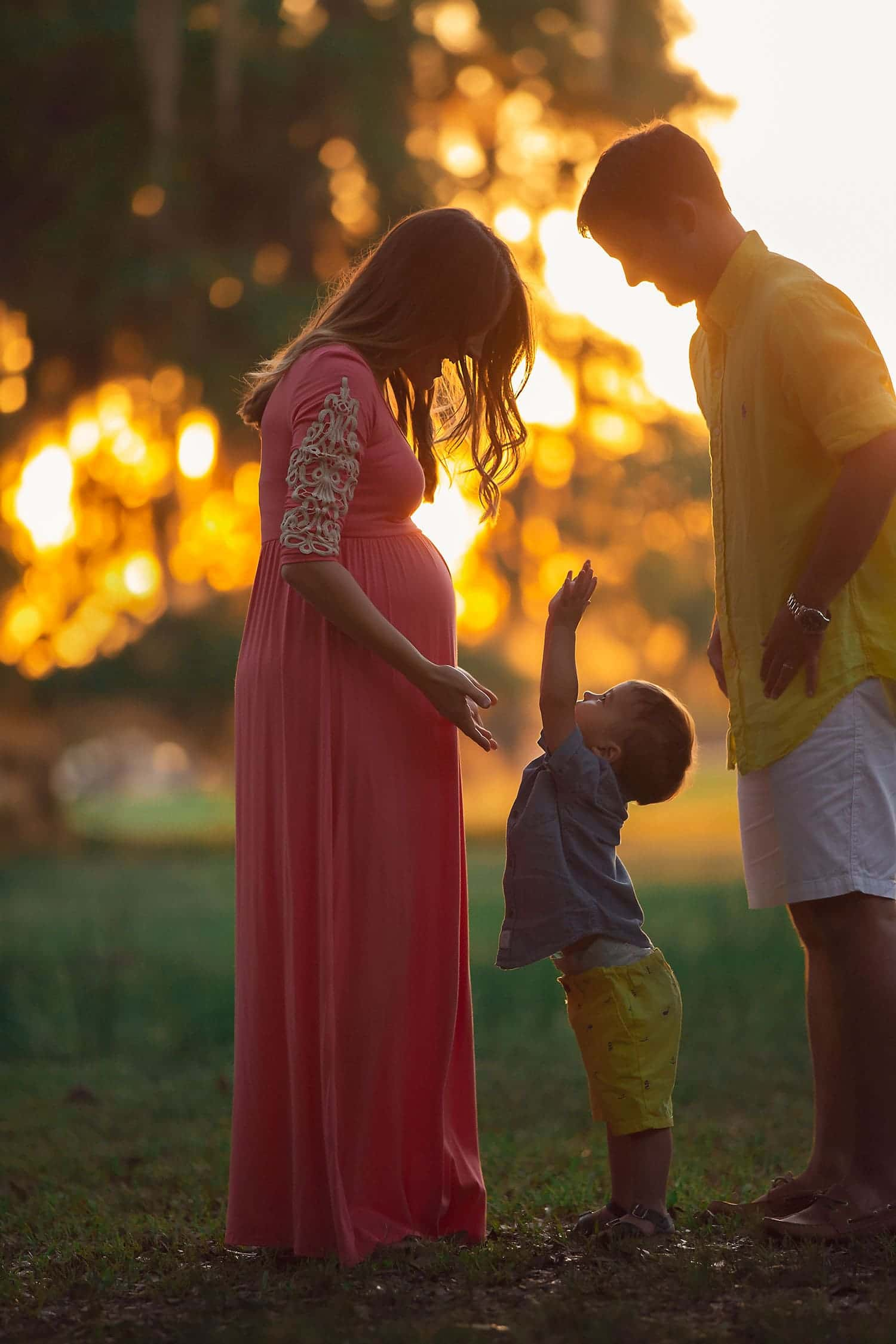 Baby boy and expecting mother by Annie Whitaker Photography