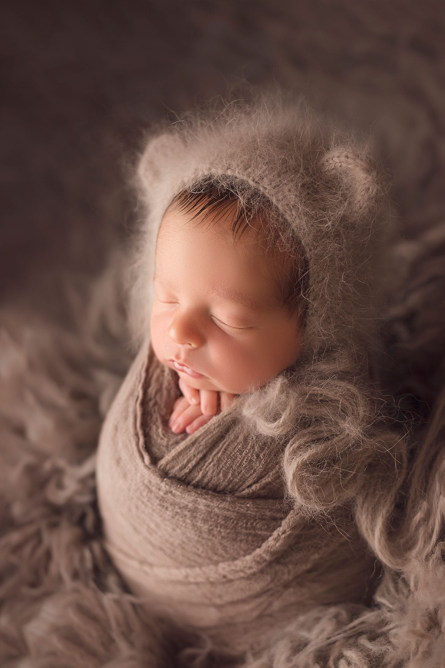 newborn boy in fuzzy bear bonnet by Annie WHitaker Photography