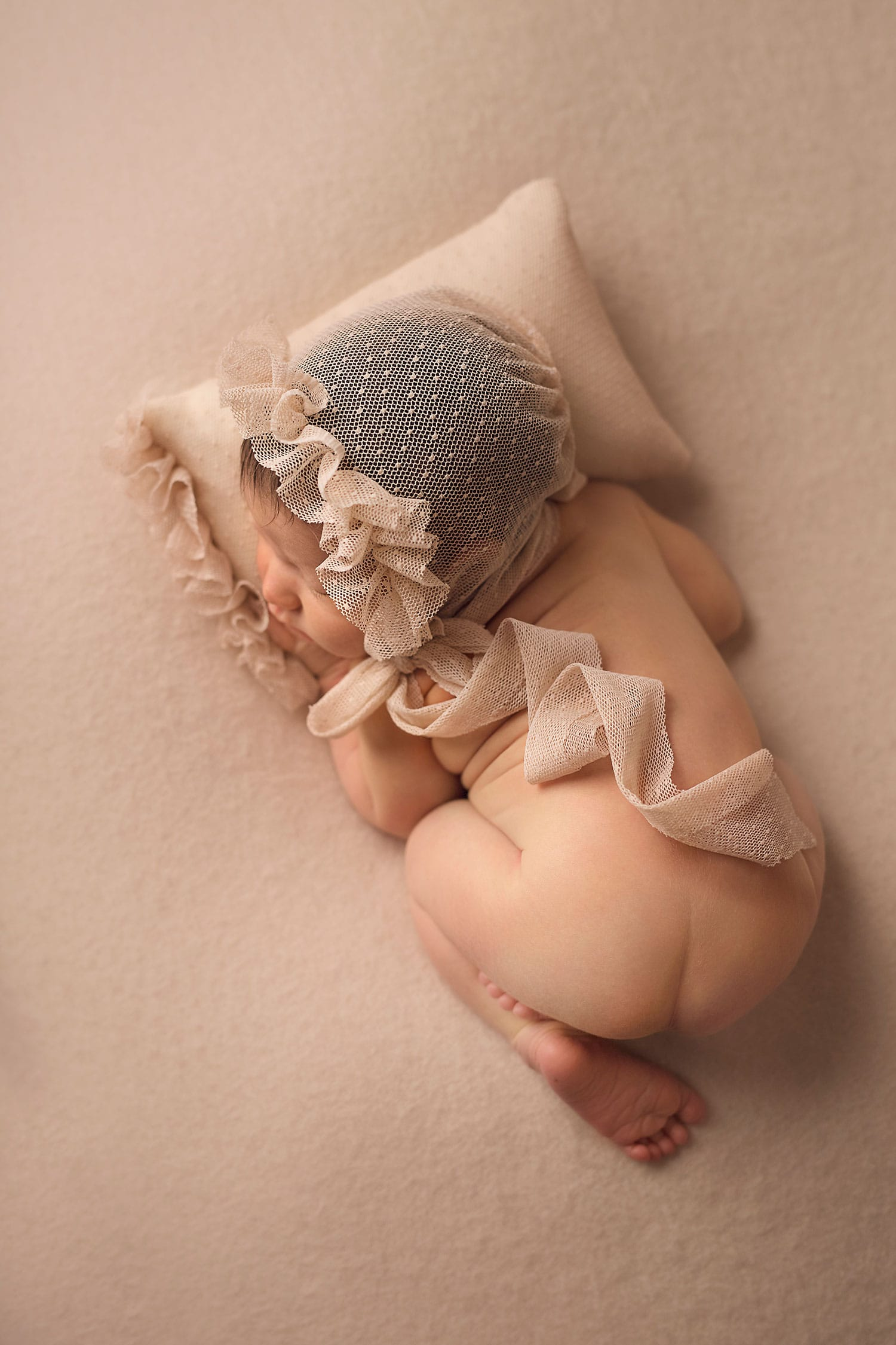newborn baby in bum up pose by Annie Whitaker Photography