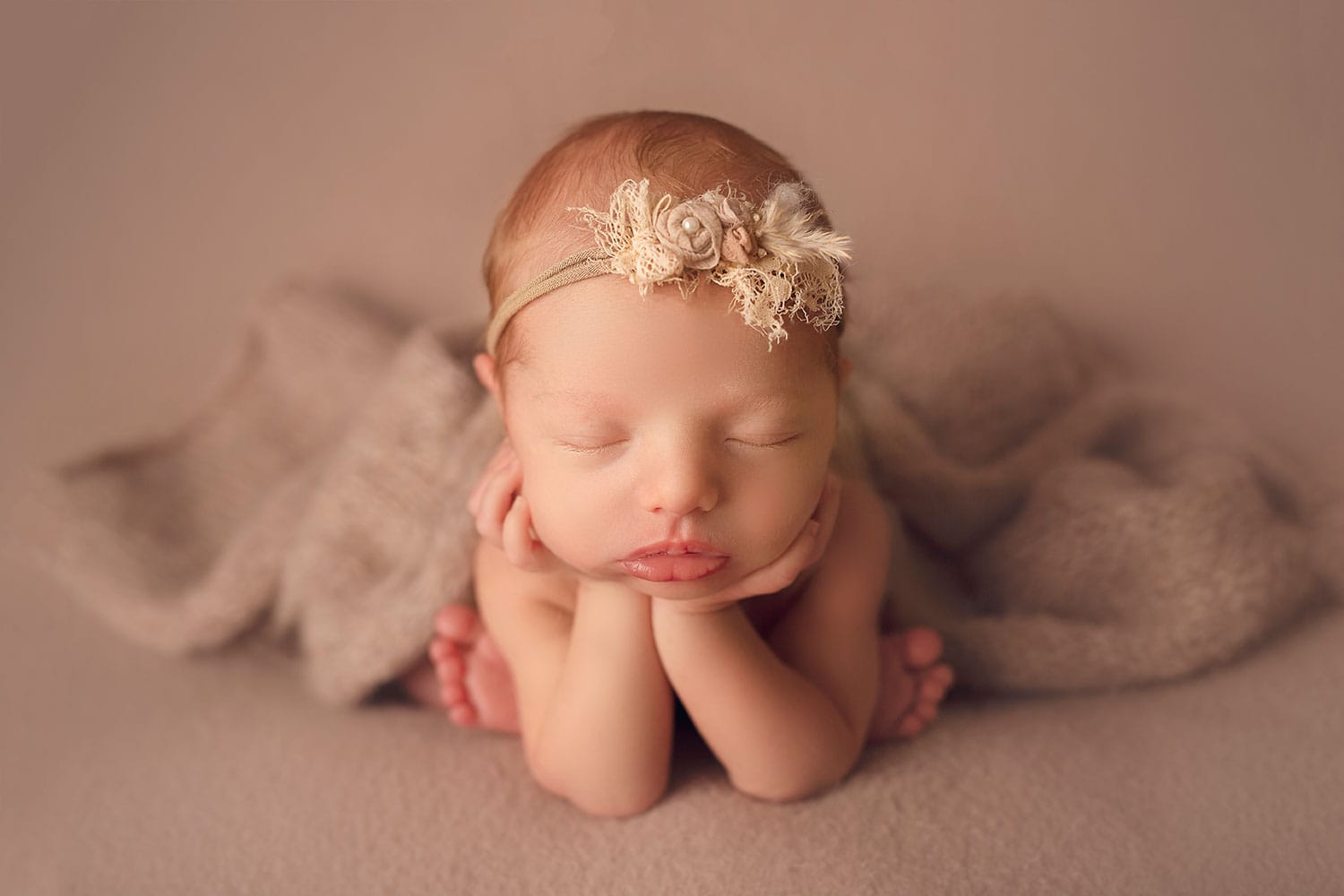 newborn baby girl in froggy pose on tan backdrop by Annie Whitaker Photography