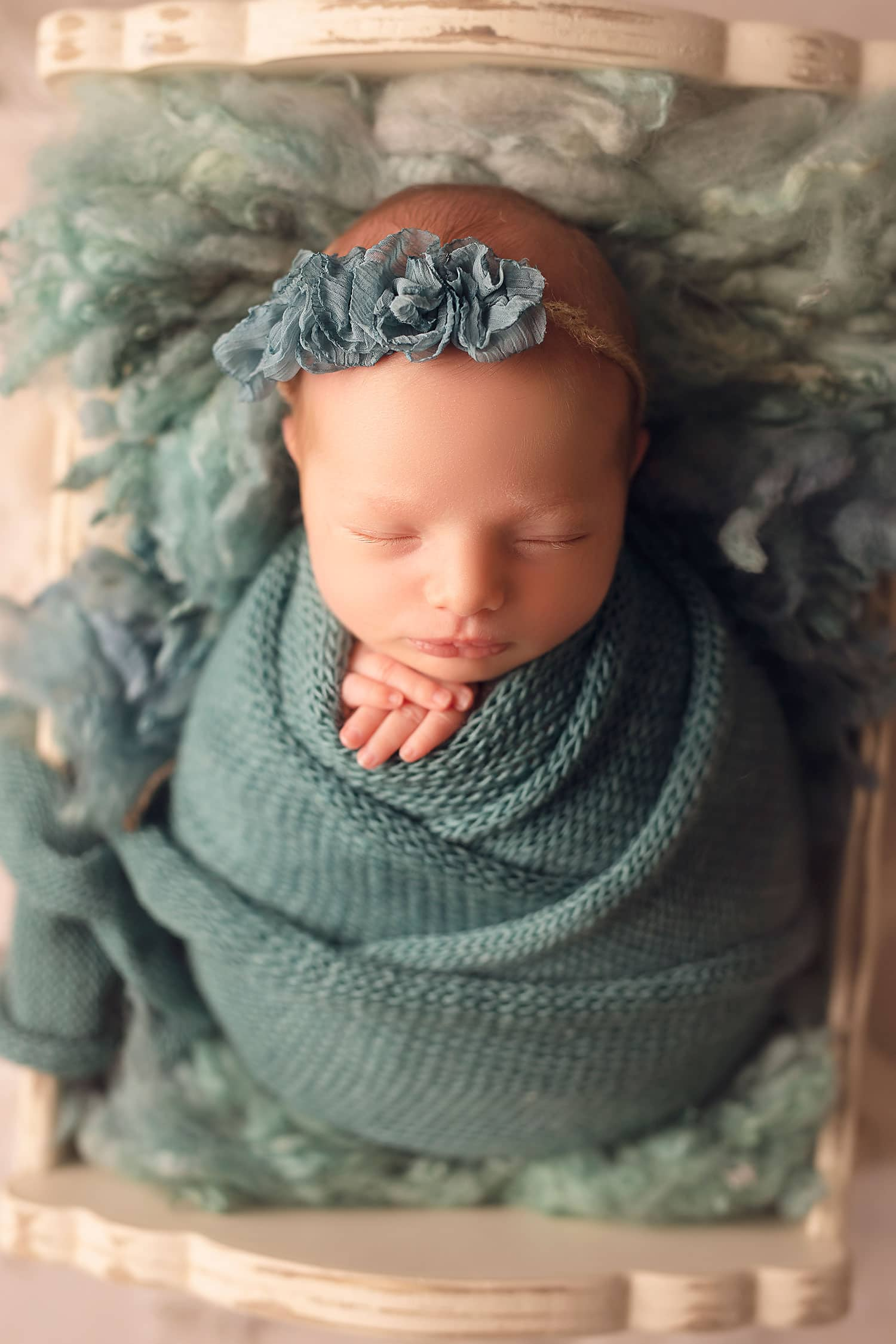 Baby girl in teal wrap by Annie Whitaker Photography