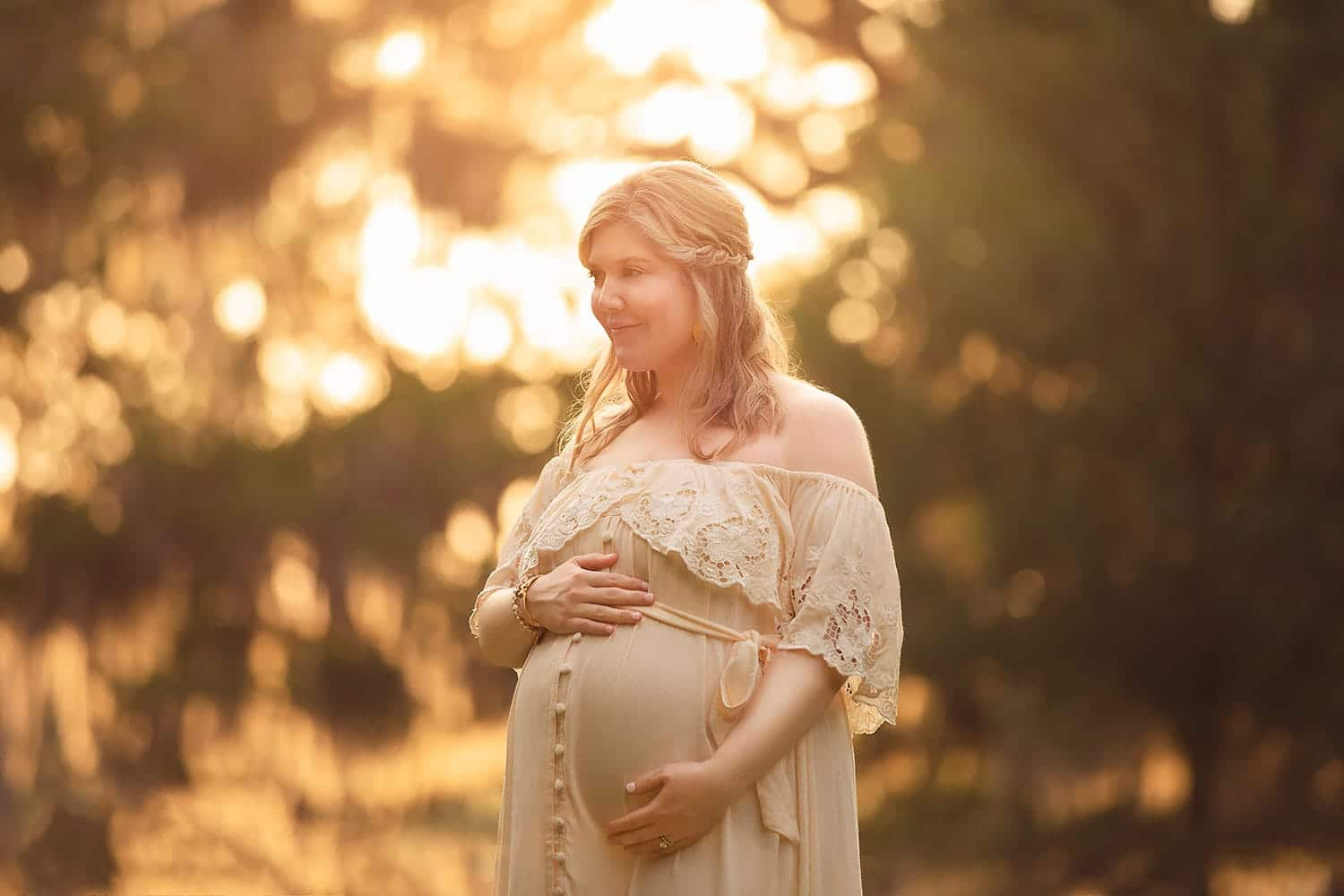 Expecting mother at sunset by Annie Whitaker photography