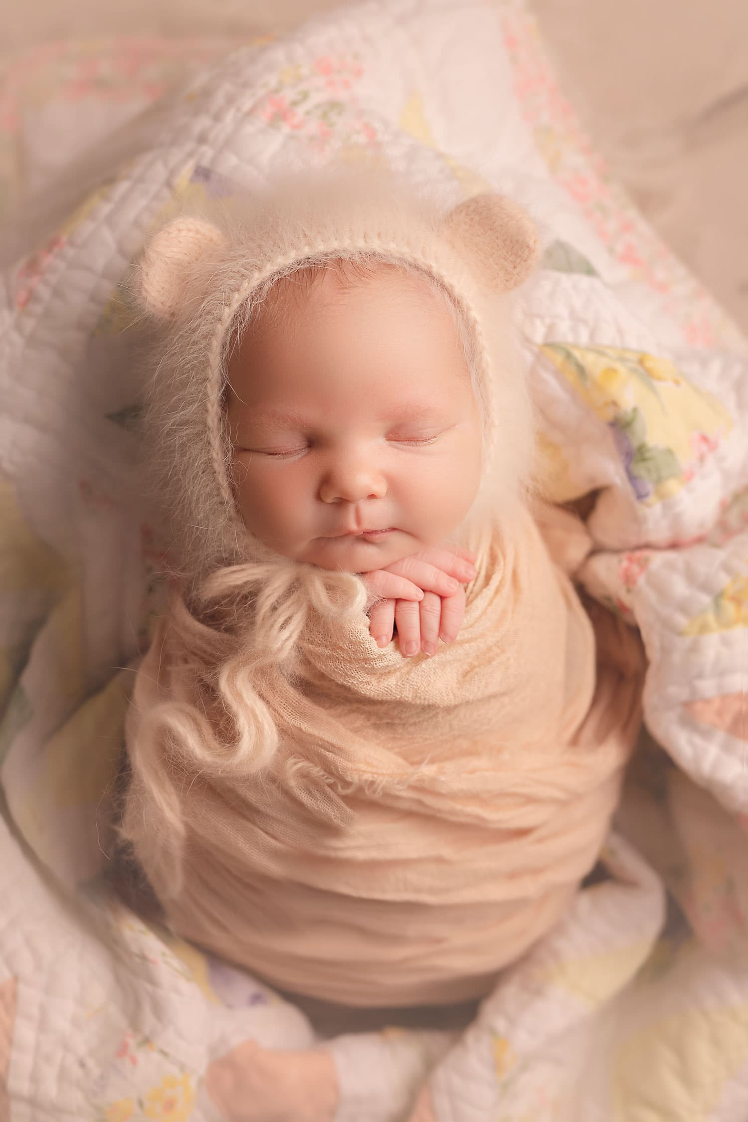 baby girl in peach bear bonnet by Annie Whitaker Photography