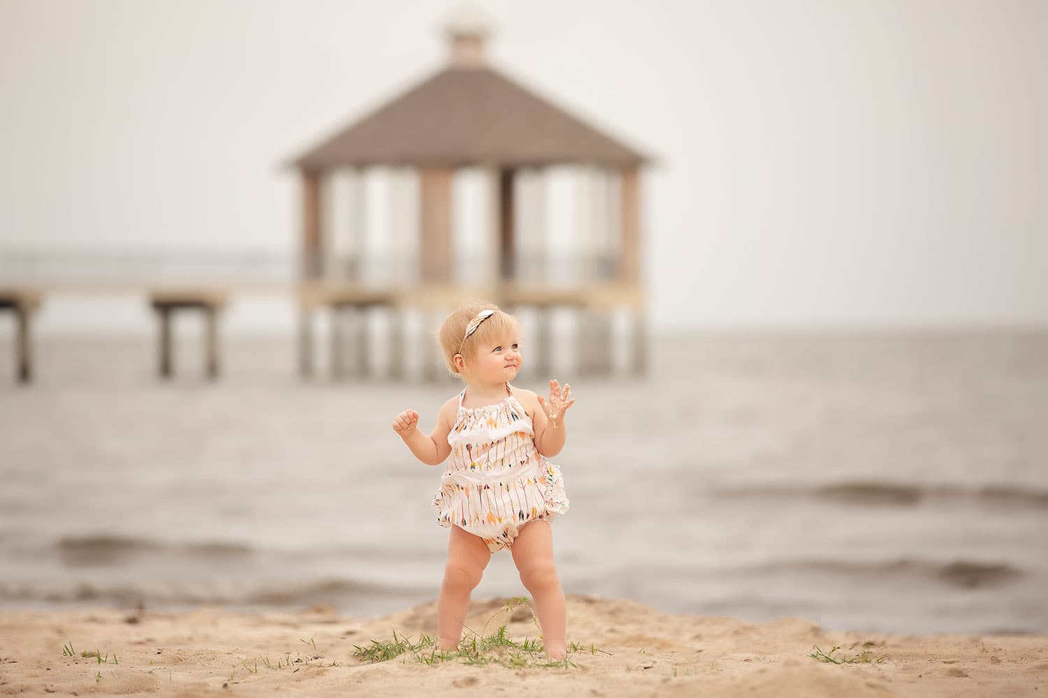 baby girl at beach in bubble by Annie Whitaker Photography