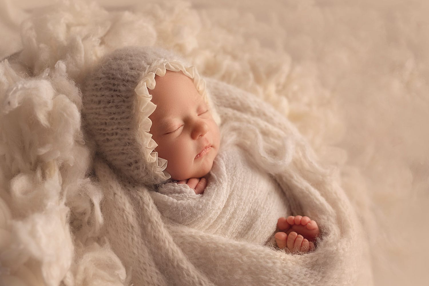 newborn baby on cream fluff by Annie Whitaker Photography