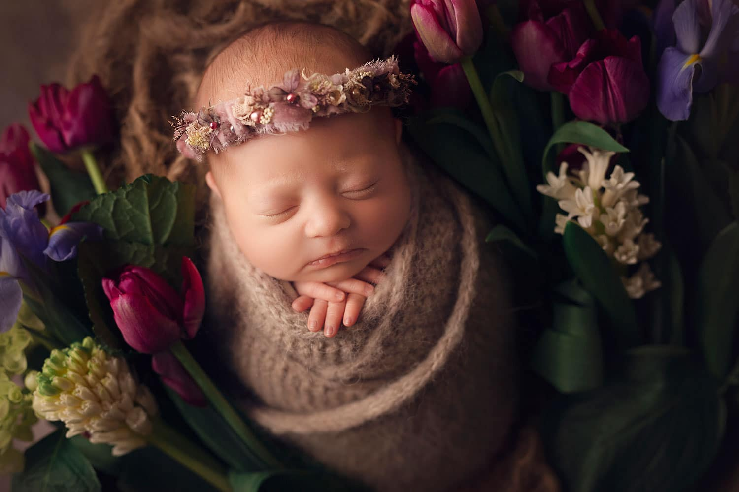 newborn girl in crate with fresh flowers by Annie Whitaker Photography
