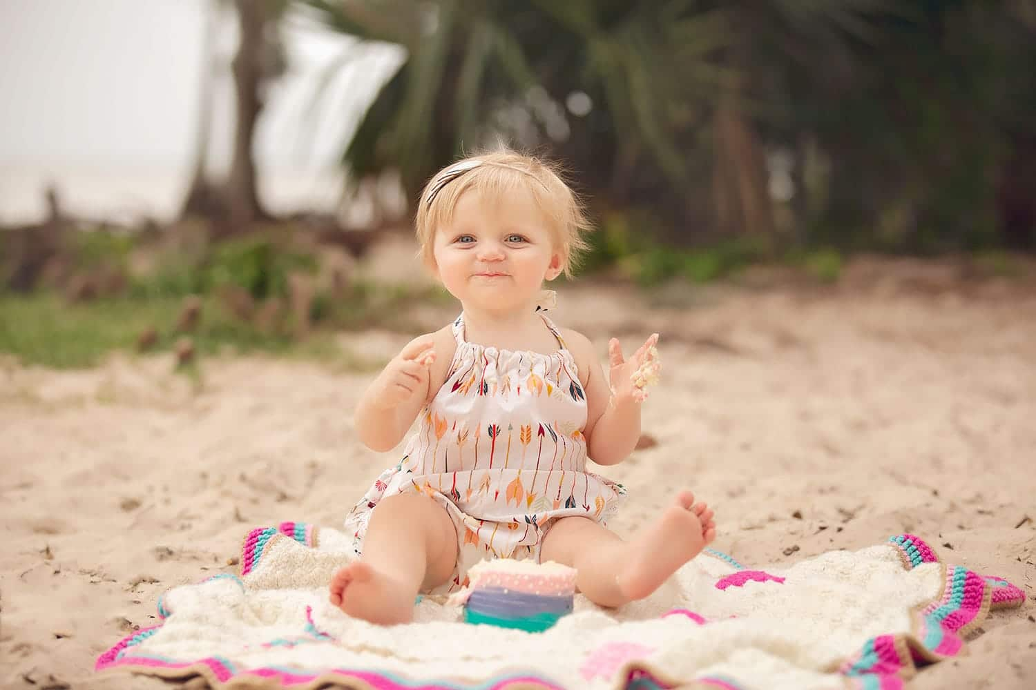 Baby girl cake smash on beach by Annie Whitaker Photography