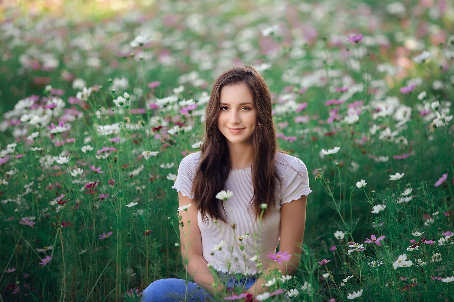 16 year old in wild flowers by Annie Whitaker Photography